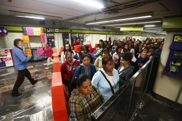 Women wait to board Women-Only passenger cars at a subway station in Mexico City